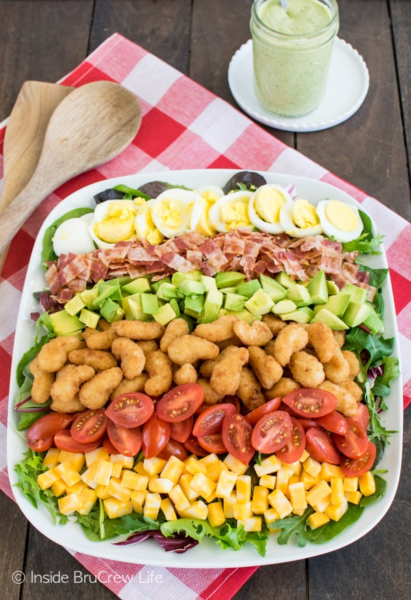 Meat, veggies, and cheese make this Avocado Shrimp Cobb Salad a great dinner choice for healthy eating.