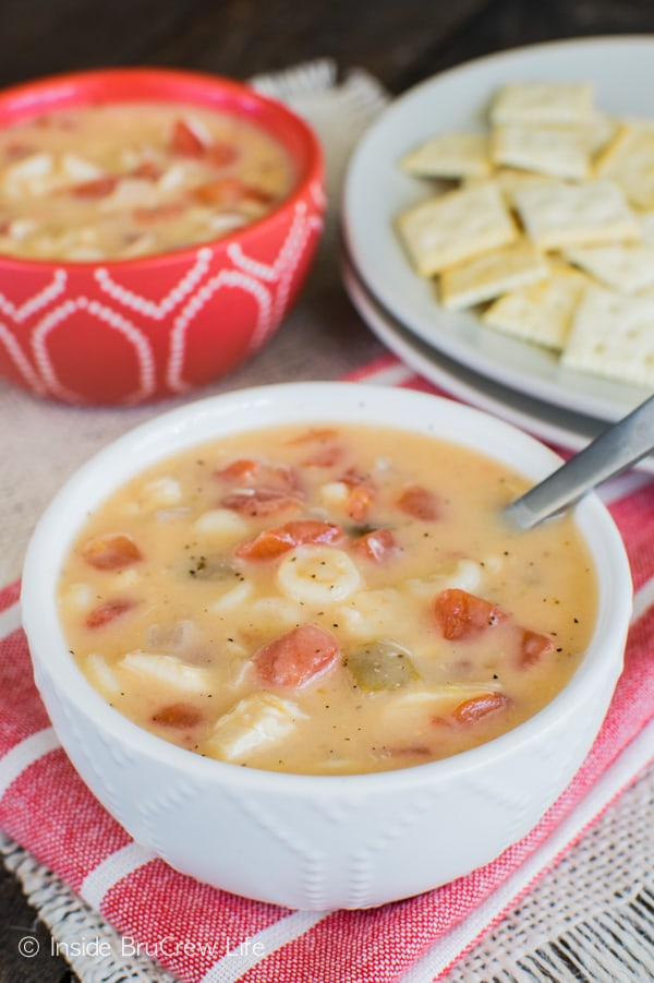 Cheesy Chicken Soup recipe - this easy one pot soup is loaded with noodles, chicken, & tomatoes. Great dinner for chilly nights.