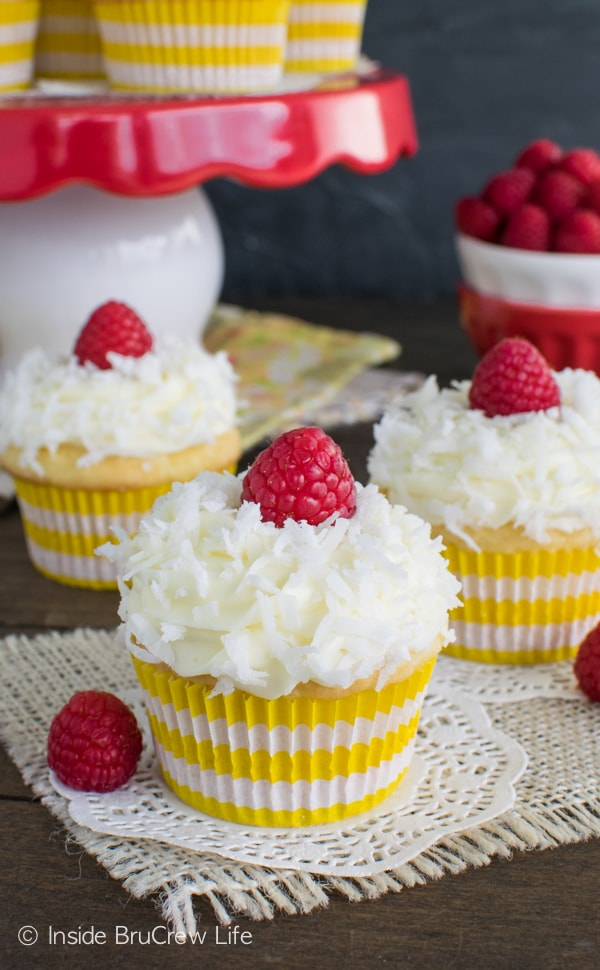 Coconut and lemon pie filling give these Lemon Coconut Cupcakes a fun spring flair. Great dessert recipe.