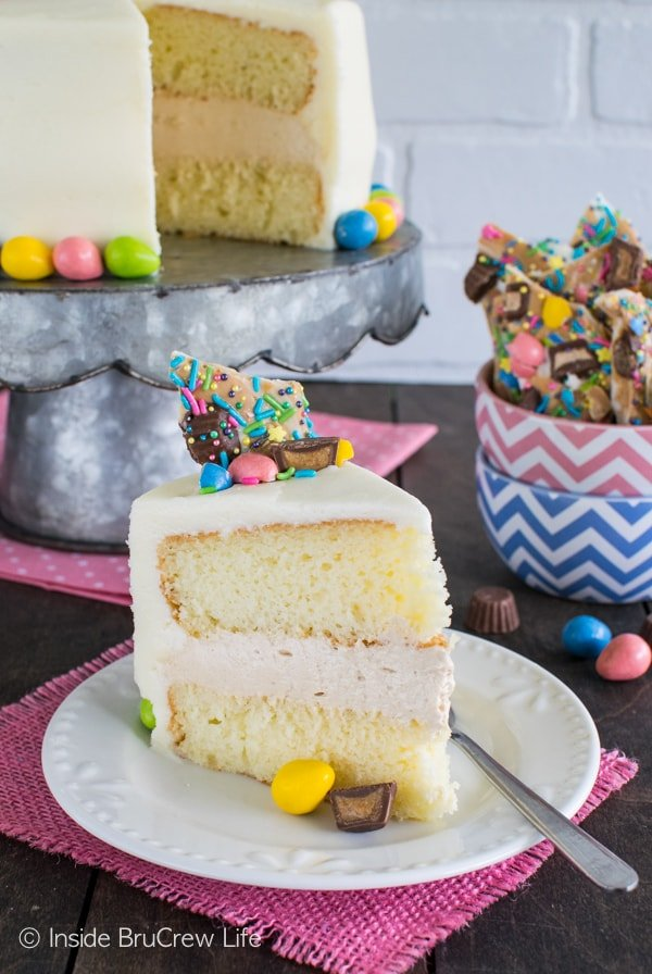Peanut Butter Mousse Cake - cake layers with a creamy peanut butter filling, frosting, and candy makes the perfect party cake recipe.