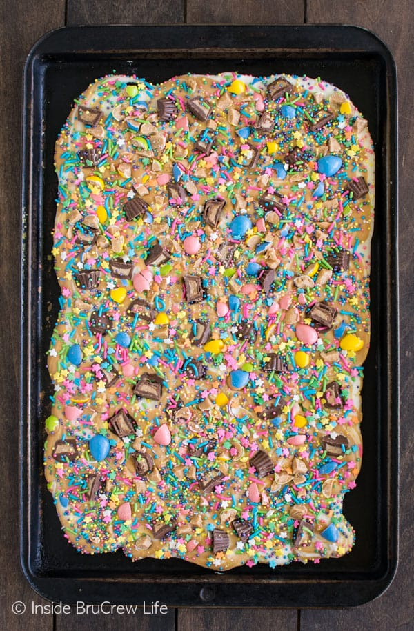 Sprinkles and candy make this White Chocolate Peanut Butter Bark a fun treat. Great no bake dessert recipe.