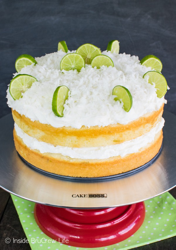 Coconut Key Lime Rum Cake - coconut frosting and a rum butter glaze make this citrus cake amazing! Great summer dessert recipe!