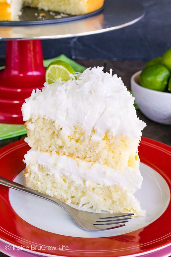 Coconut Key Lime Rum Cake - a sweet rum glaze and coconut frosting makes this citrus cake taste absolutely amazing. Try this easy recipe for spring parties. #keylime #rumcake #coconut #layercake #cake #doctoredcakemix