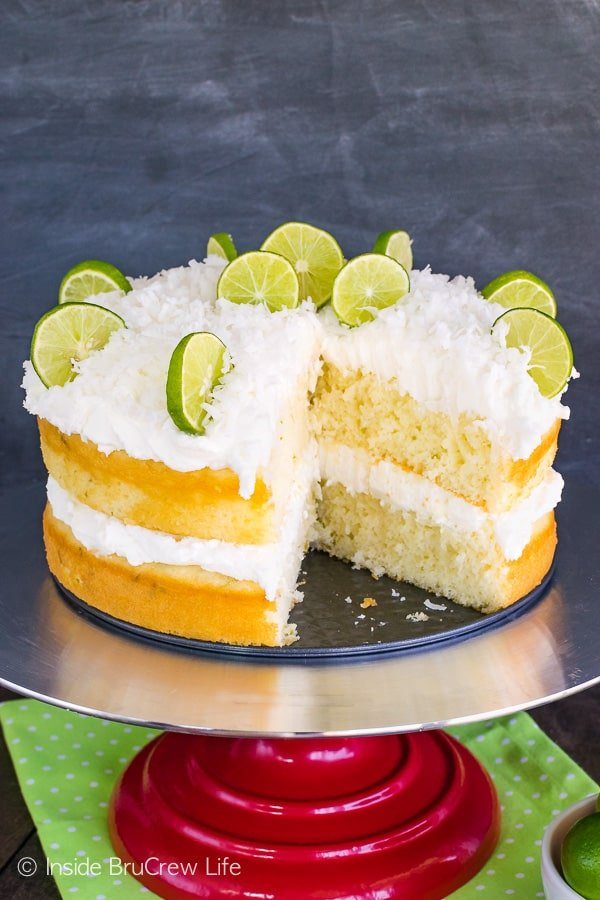 Coconut Key Lime Rum Cake - key lime cake layers drizzled with rum glaze and topped with fluffy coconut frosting makes a delicious recipe to share at spring and summer parties! #keylime #rumcake #coconut #layercake #cake #doctoredcakemix