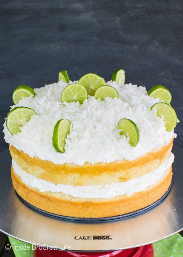 Coconut Key Lime Rum Cake - fluffy coconut frosting adds a sweet topping to this easy citrus cake! Great summer dessert recipe!
