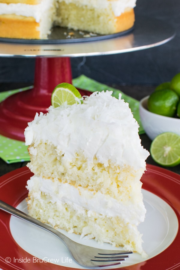 Citrus rum butter glaze and fluffy coconut frosting adds a sweet twist to this Coconut Key Lime Rum Cake. Great summer dessert recipe!