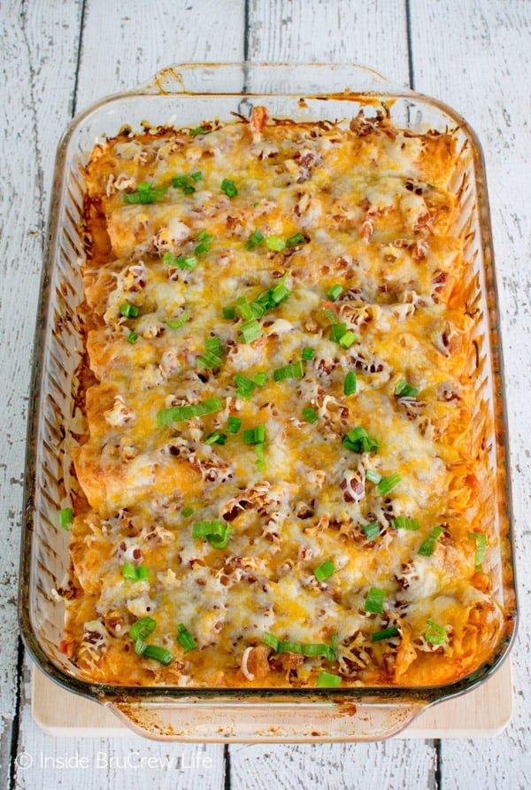 Barbecue chicken, bacon, and cheese give these Monterey Chicken Enchiladas a fun twist. Great dinner recipe!