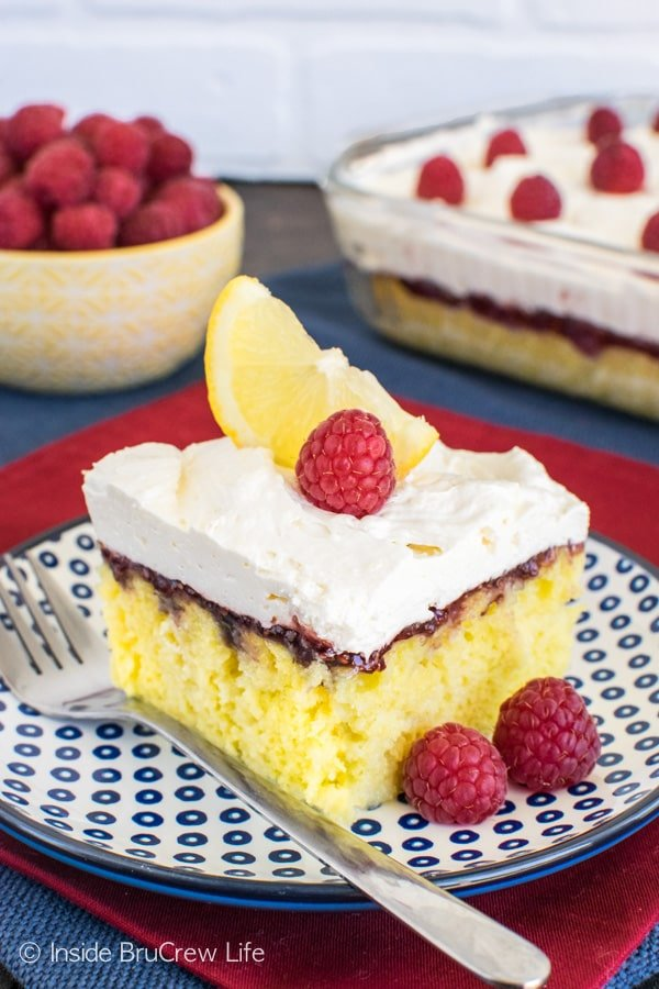 Raspberry Lemon Cake - lemon mousse and raspberry preserves give this easy cake recipe a fun twist. Perfect recipe for picnics and parties.
