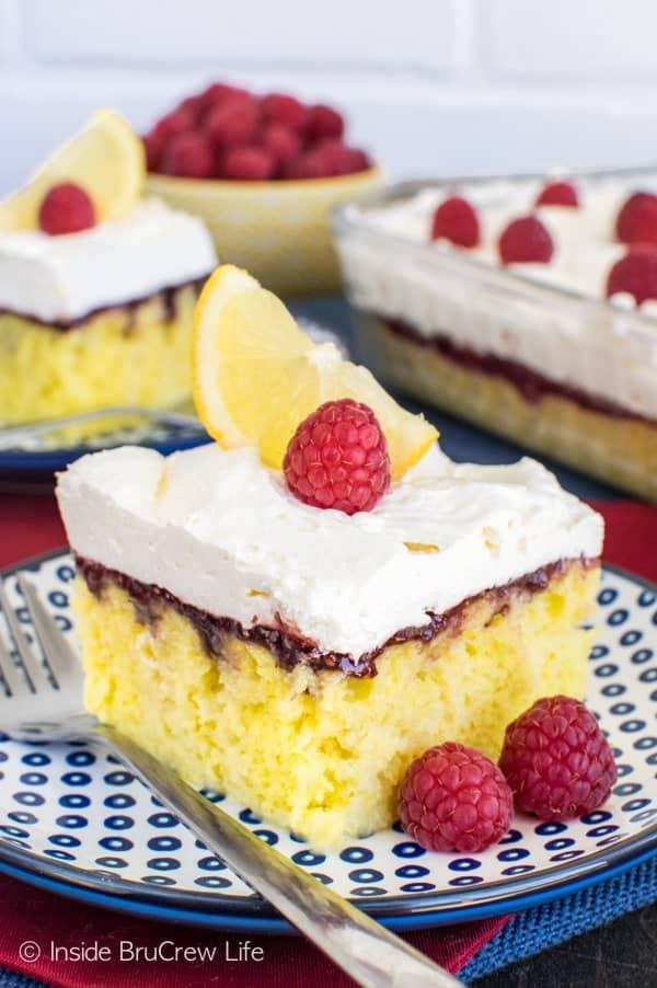 Raspberry Lemon Cake - the easy lemon cake is topped with raspberries and a light lemon mousse. Perfect summer dessert recipe!