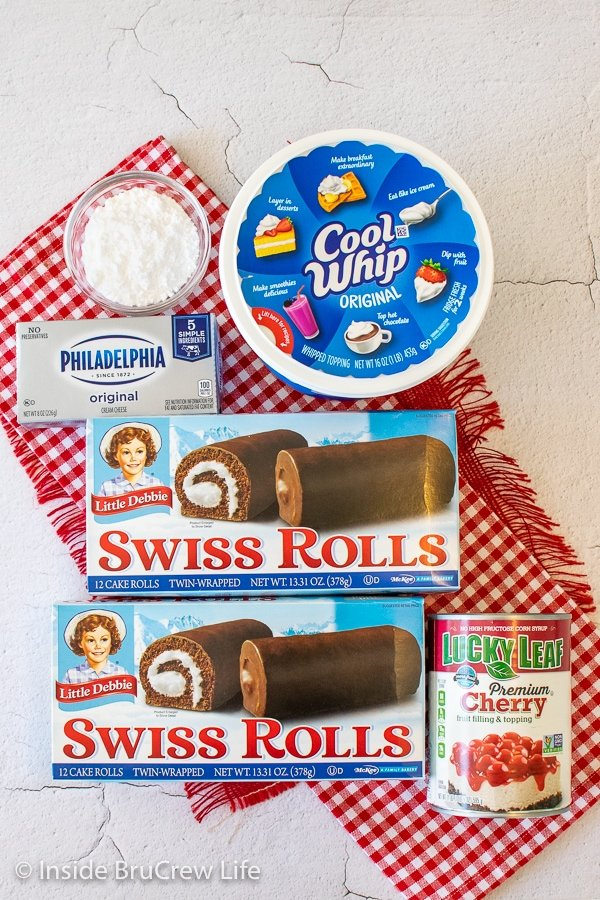 Overhead picture of the ingredients needed to make a no bake cherry swiss rolls cake