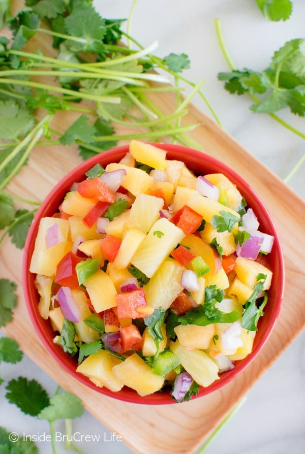 This sweet and spicy Pineapple Peach Salsa is perfect for adding to salads, chicken, or tacos. Great dinner recipe!