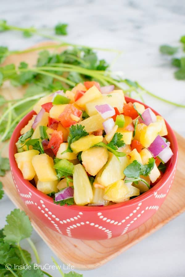 Pineapple Peach Salsa - diced fruit and veggies makes this spicy and fresh salsa perfect for salads & tacos. Great dinner recipe!