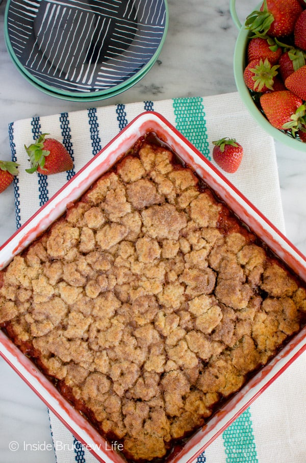 An overhead picture of a white pan with strawberry cobbler baked in it