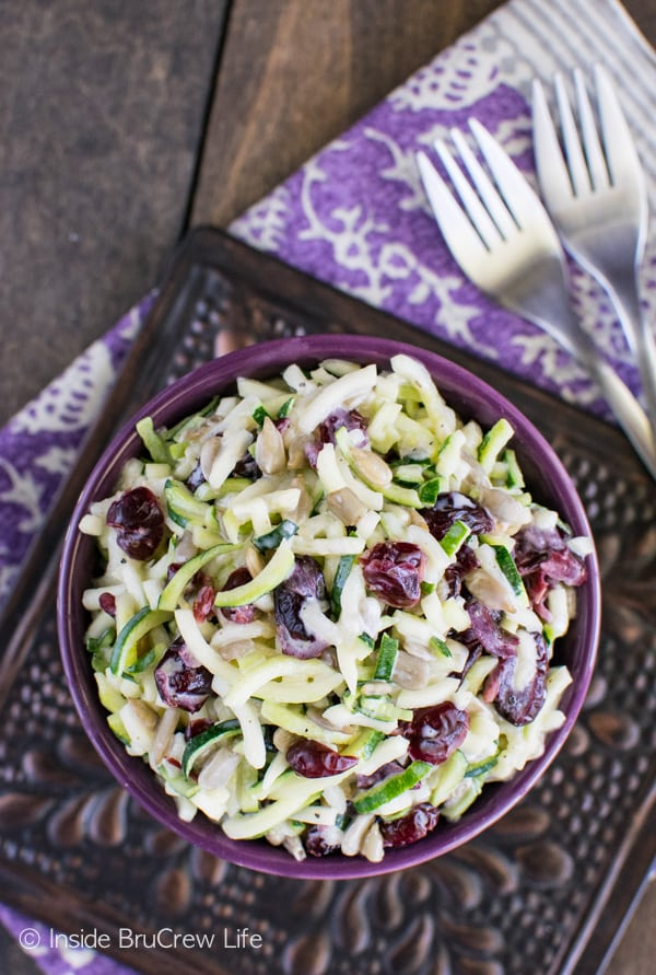 Berries and nuts give this Cranberry Zucchini Slaw a nice sweet and salty flair. This is a great salad recipe for picnics!