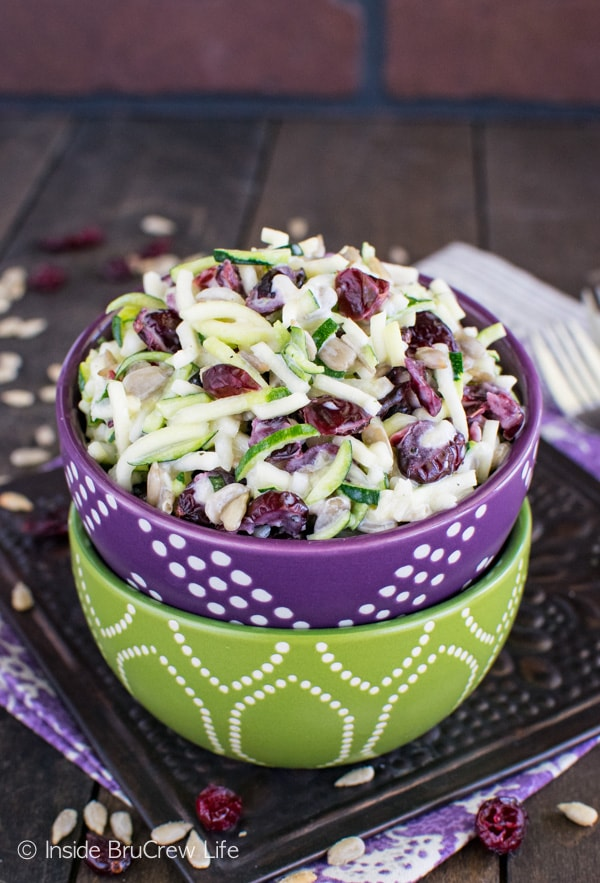 Cranberry Zucchini Slaw - this fresh salad has nuts and berries for a great sweet and salty flavor. This easy recipe is perfect for summer picnics!