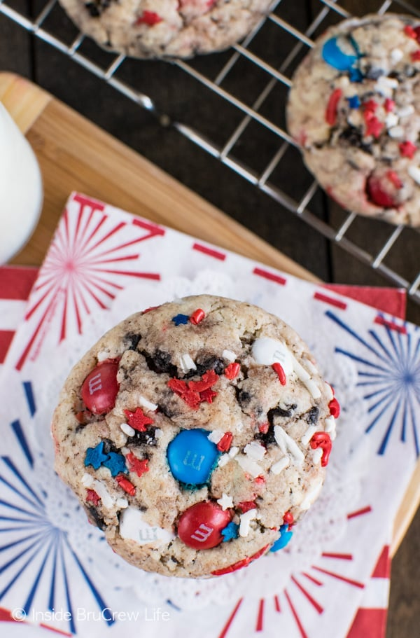 An overhead picture of a Fireworks Cookies and Cream Cookie with lots of red white and blue sprinkles and M&M candies in it