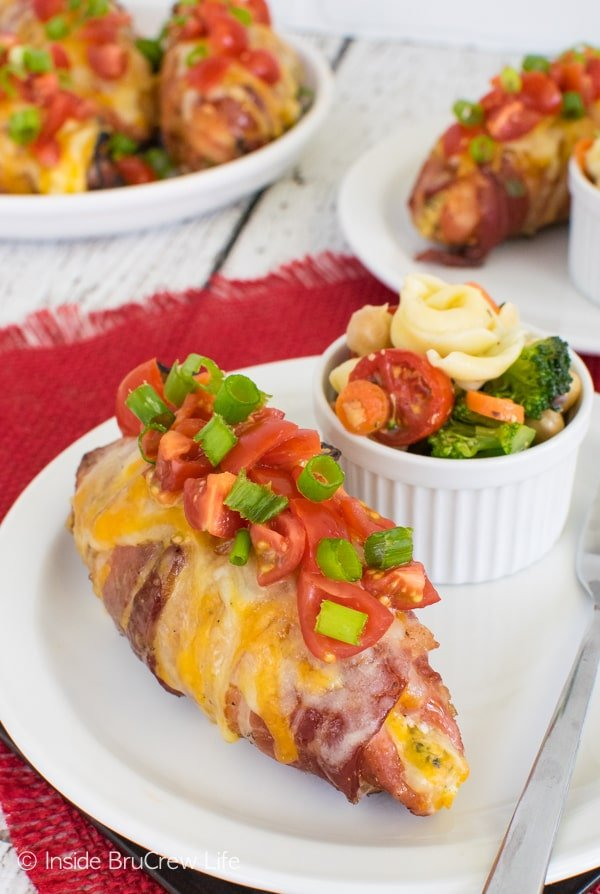 Broccoli Cheese Stuffed Pork Tenderloins - gooey cheese, broccoli, and tomatoes make these tenderloins an amazing dinner recipe for the grill.