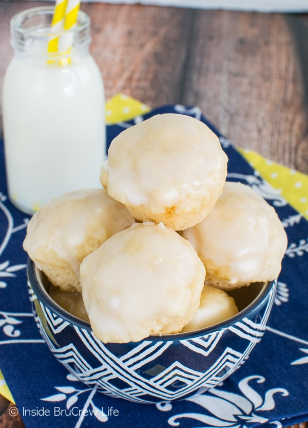 Lemon glaze on these Mini Lemon Donut Muffins makes them disappear in a hurry. Awesome little breakfast recipe!