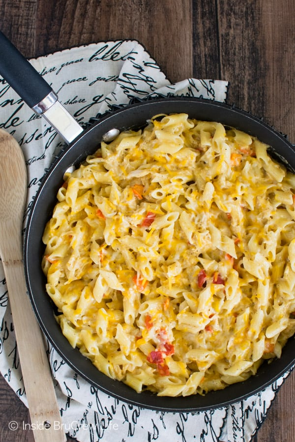Cheesy Chicken Pasta - this easy 30 minute meal is loaded with gooey cheese and pasta. Make this recipe for busy nights and watch it disappear. #pasta #skillet #30minutemeal #chicken #cheese #dinner #recipe