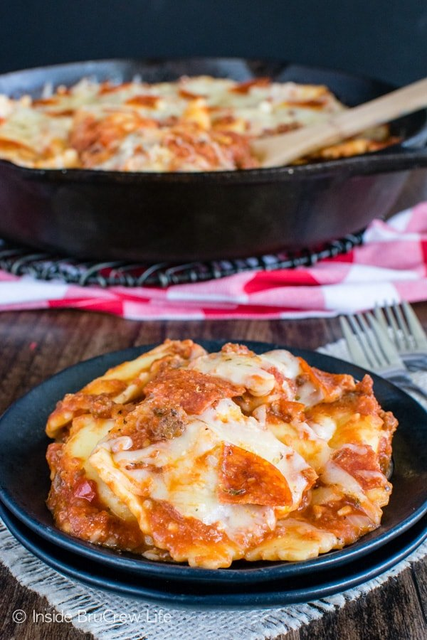 Meat Lover's Pizza Skillet Ravioli - three kinds of meat and lots of gooey cheese make this dinner a hit with everyone. Quick and easy recipe for busy nights!