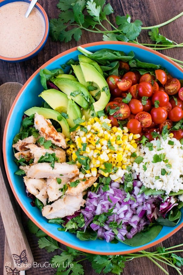 Mexican Street Corn Chicken Salad - grilled corn, veggies, chicken, and a chili lime ranch dressing makes this salad a hit for dinner!