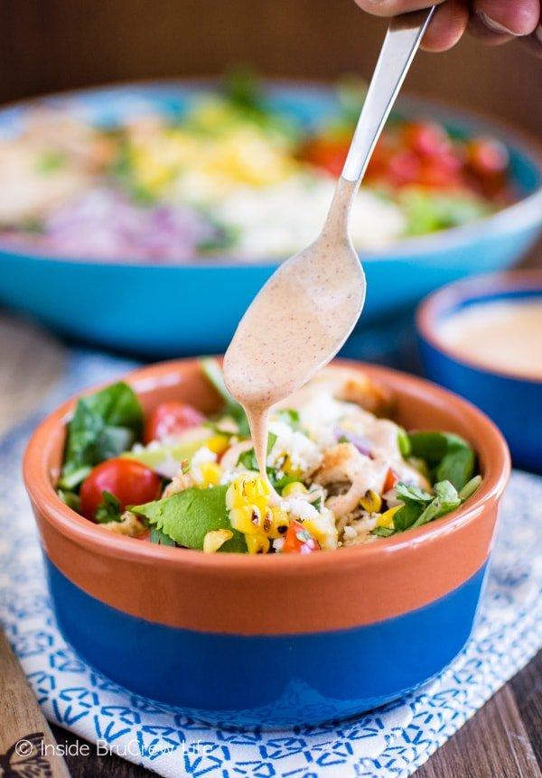 Mexican Street Corn Chicken Salad - chili lime ranch dressing drizzled over corn, cheese, chicken, and greens is a great way to do dinner! Awesome recipe!
