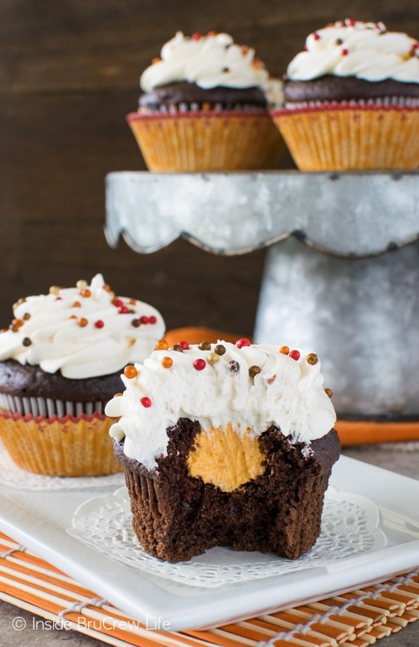 Chocolate Pumpkin Cream Filled Cupcakes - chocolate cupcakes with a pumpkin cream center is the perfect recipe for fall parties