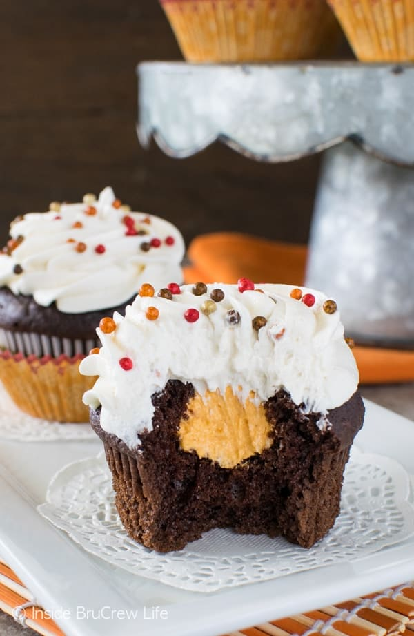 Chocolate Pumpkin Cream Filled Cupcakes - the hidden pumpkin cream center adds a fun flair to these cupcakes. Great recipe for fall parties!