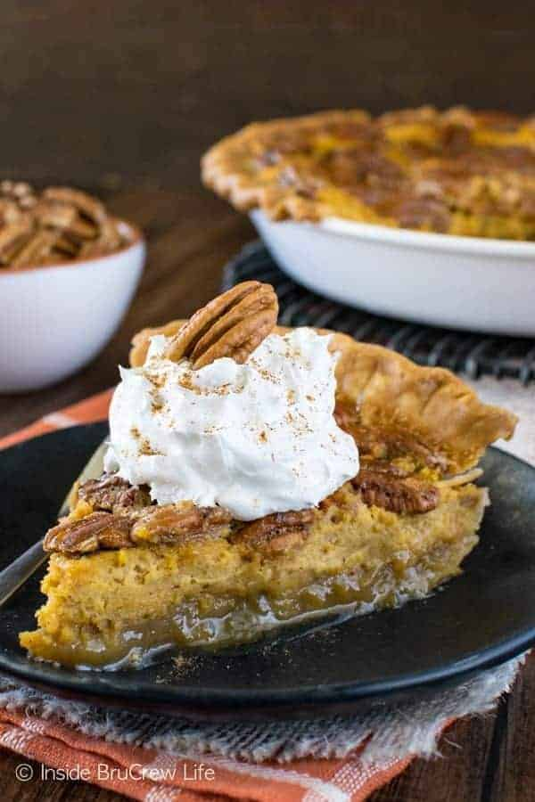 Pecan Pumpkin Cheesecake Pie - layers of pumpkin cheesecake and gooey pecan pie make this a must make fall dessert! Great recipe for Thanksgiving!