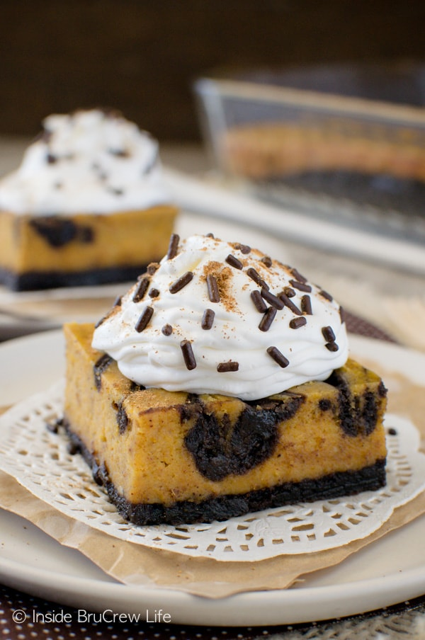 Brownie Swirled Pumpkin Cheesecake Bars - pockets of chocolate in these pumpkin bars makes a delicious fall dessert. Great recipe for parties.