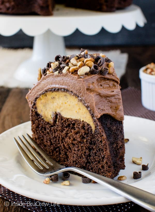 Chocolate Pumpkin Cheesecake Bundt Cake - a hidden pumpkin center and creamy chocolate frosting will make this cake a favorite treat at fall parties! Great dessert recipe!