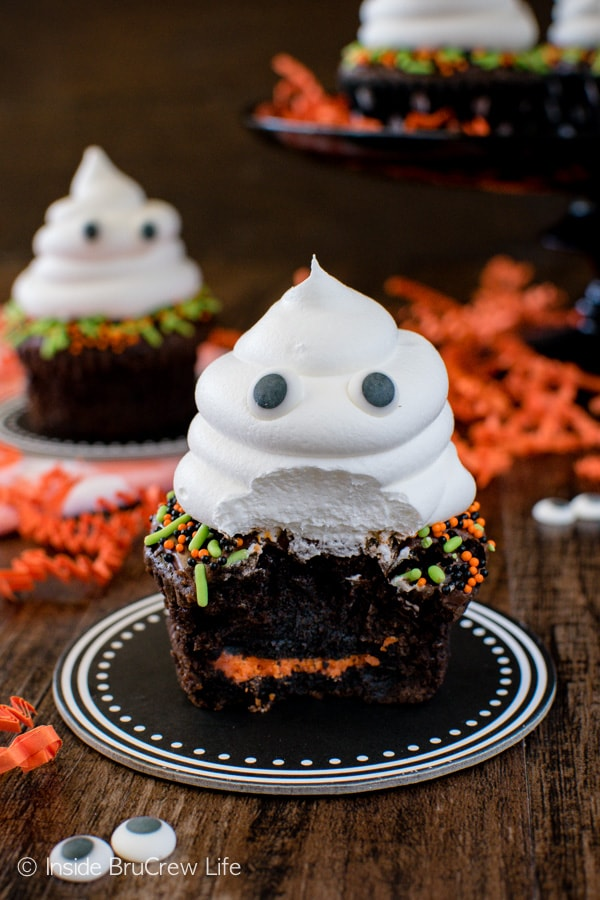 A hidden Oreo cookie and a friendly ghost on top makes these Ghost Brownie Cupcakes a fun Halloween treat!
