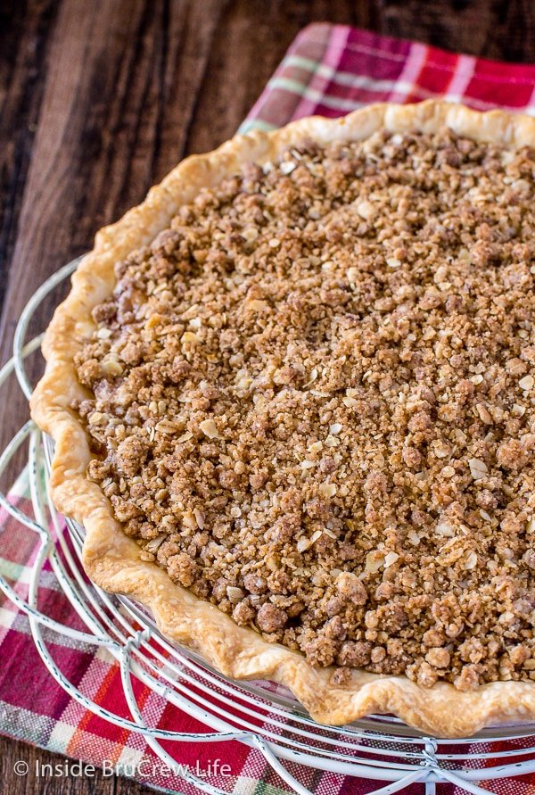 A close up of crumb topping on an apple crisp pie
