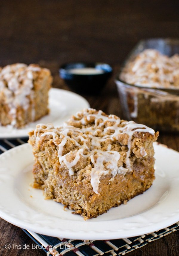 Banana Caramel Coffee Cake - a sweet caramel cheesecake is hidden under crumbs and glaze. This is an awesome breakfast or dessert recipe!