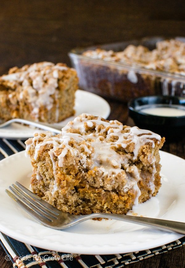 Banana Caramel Coffee Cake - layers of banana cake, caramel cheesecake, crumbs, & glaze will have you going back of another piece. Great breakfast or dessert recipe!