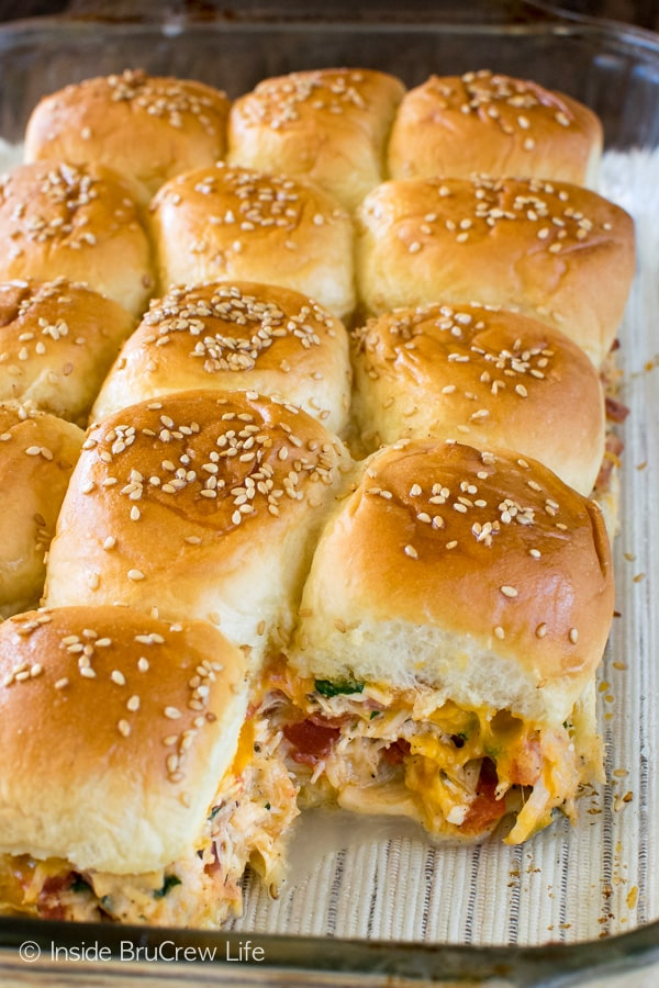 Cheesy Chicken Sliders - meat, veggies, & cheese fill these easy dinner rolls with goodness. Great recipe for busy nights or game day!!!