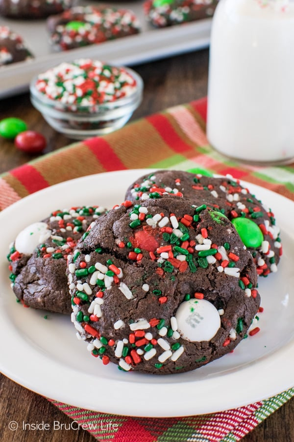 Chocolate Mint Pudding Cookies - these soft chocolate cookies are loaded with mint flavor, candies, & sprinkles. Such a fun recipe for holiday trays and parties!