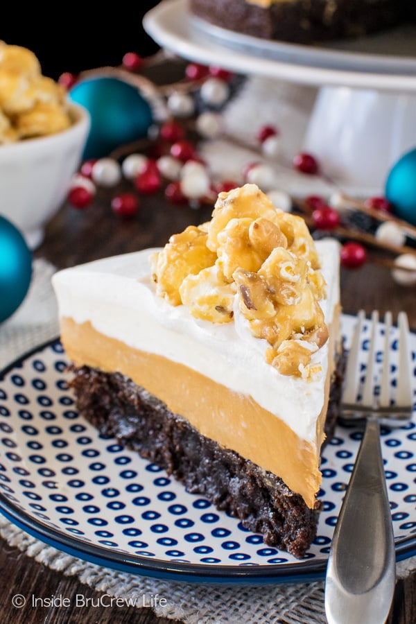 White Chocolate Caramel Mousse Brownie Cake - layers of no bake cheesecake mousse & fudgy brownies make this dessert recipe a delicious treat to share with family and friends!