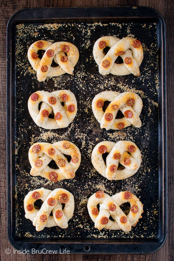 Easy Pepperoni Cheese Pretzels - these easy breadsticks are full of cheese and pepperoni and are baked in a fun pretzel shape. Great appetizer for game day for bread to go with dinner!