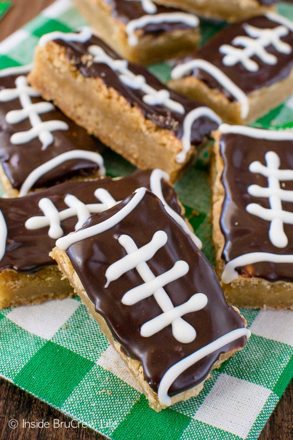 Football Cookie Bars - chewy cookie bars topped with chocolate. Cute football treat recipe for game days or sports parties!