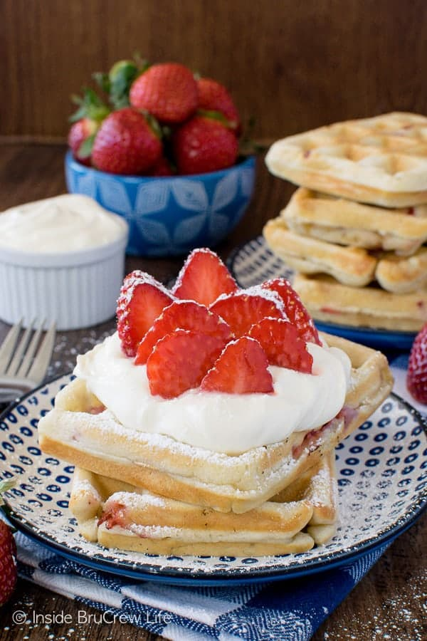 Homemade Strawberry Waffles - fill your freezer with a batch of these easy waffles. Lemon cream and berries make this a must make breakfast recipe!