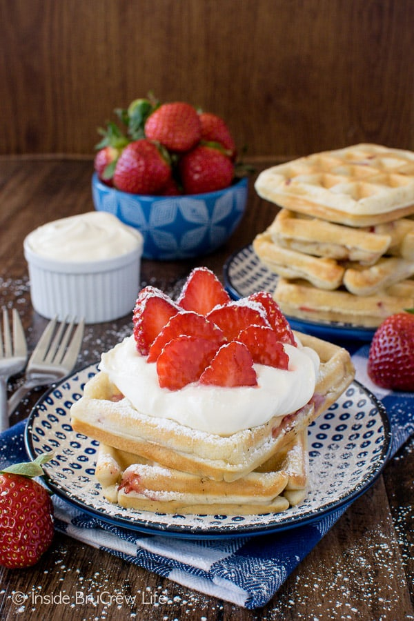 Homemade Strawberry Waffles - these easy breakfast waffles are the perfect thing to fill your freezer with. Fresh berries and lemon cream make these a delicious breakfast recipe!
