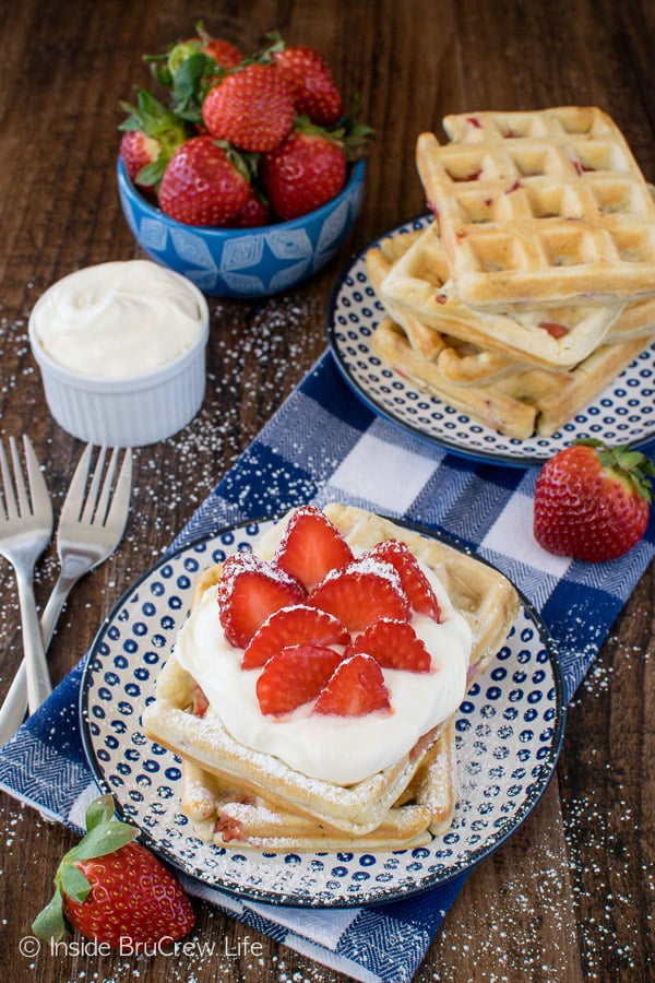 Homemade Strawberry Waffles - these easy waffles are full of fresh berries! Top them with lemon cream and powdered sugar for a fun breakfast recipe!