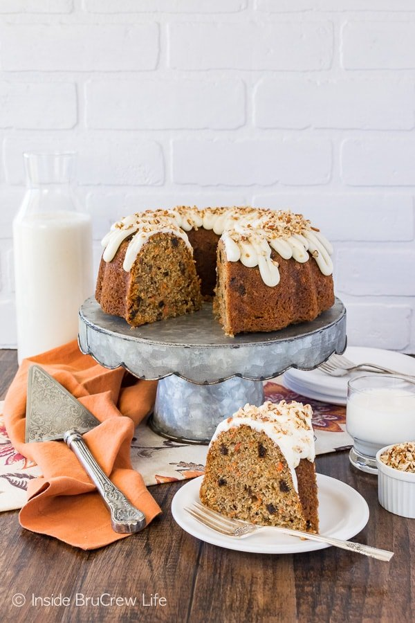 Carrot Bundt Cake - this easy homemade spice cake is loaded with flavor! Carrots, nuts, and raisins add a great texture to the recipe! Perfect for Easter parties or dinners!