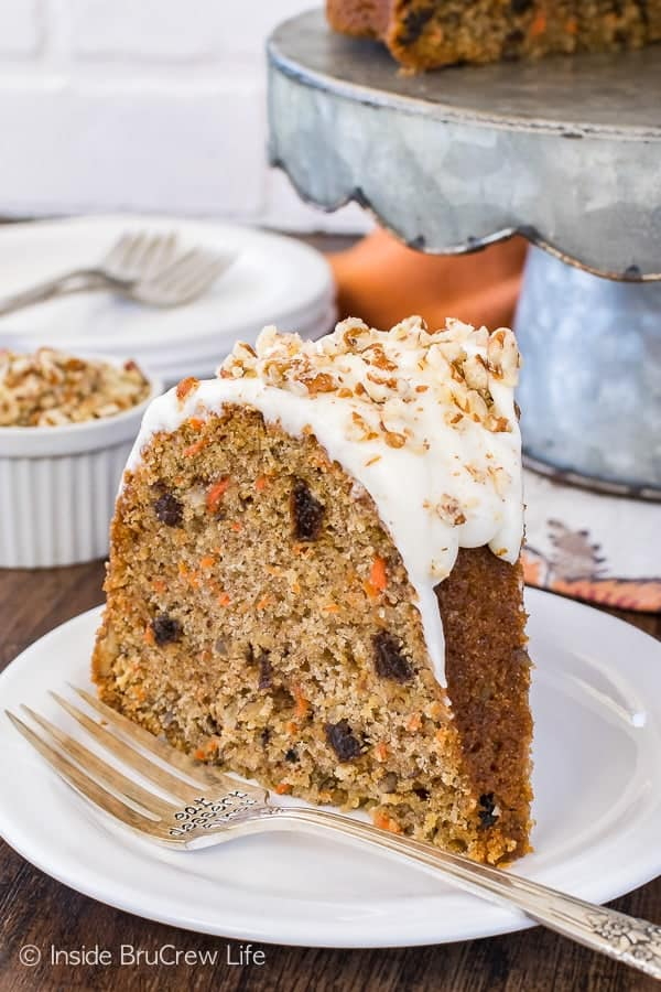 Carrot Bundt Cake - this sweet homemade cake is loaded with carrots, nuts, and raisins. Great recipe for Easter parties or dinners!