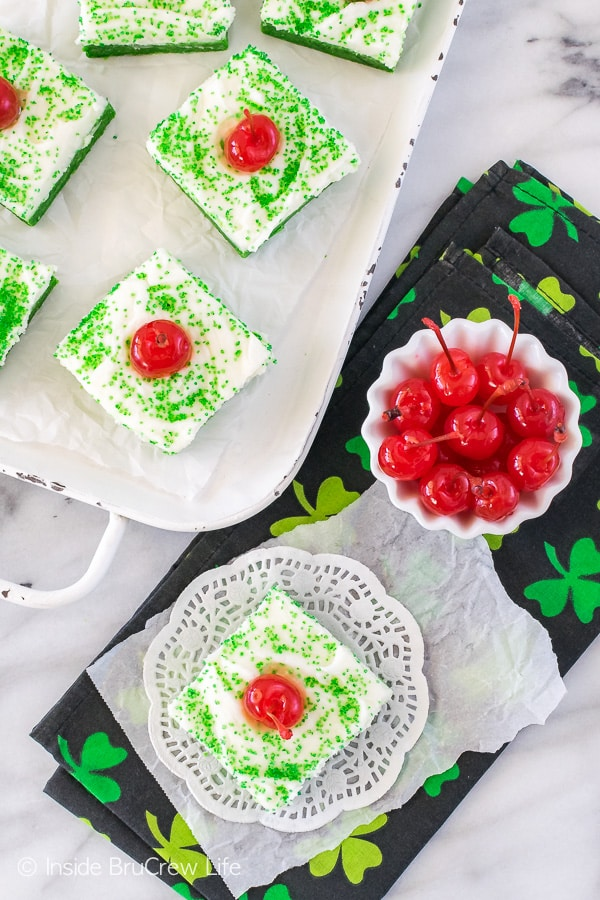 Shamrock Shake Sugar Cookie Bars - easy cookie bars that are made and frosted in one pan. The mint bars are made to look like the popular shake. Easy dessert recipe for St. Patrick's day parties!