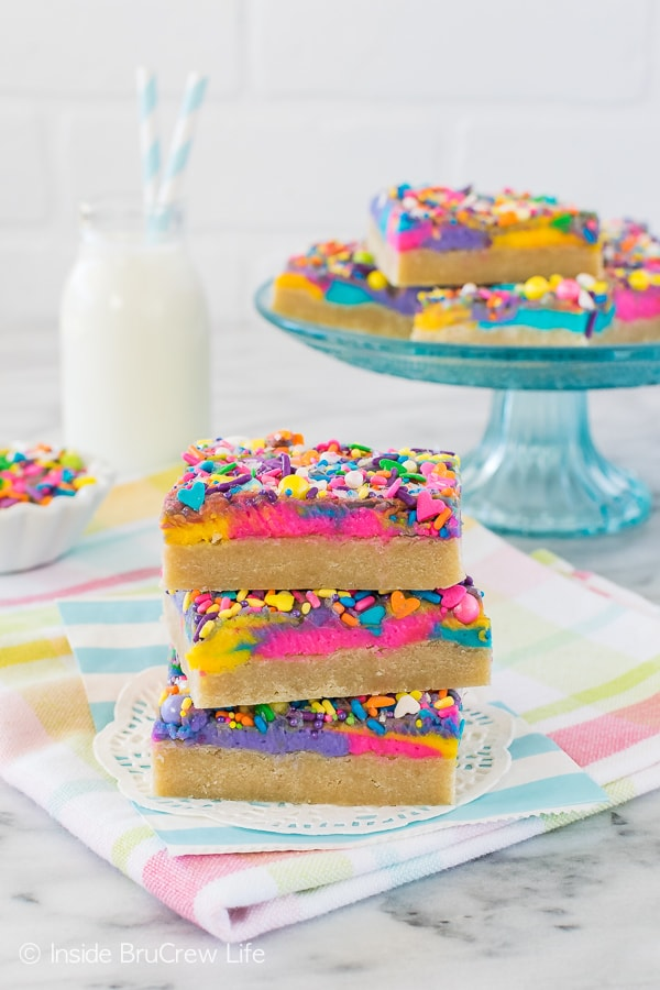 Vanilla Unicorn Sugar Cookie Bars - easy cookie bars topped with lots of bright frosting and sprinkles. Great dessert recipe for any party!