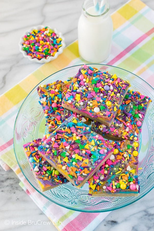 Vanilla Unicorn Sugar Cookie Bars - easy cookie bars loaded with colorful frosting and sprinkles. Great dessert recipe that can be changed to match any party!