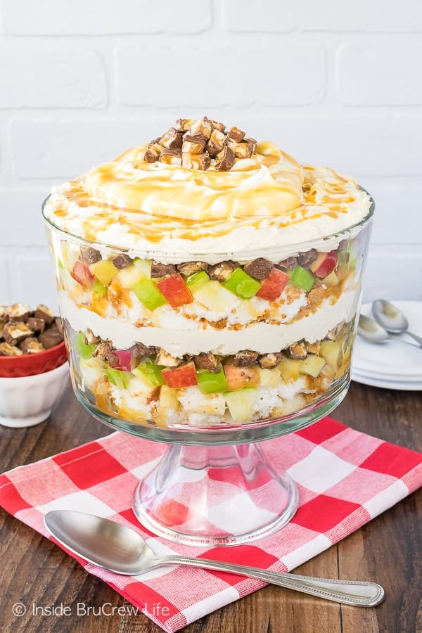 Apple Snickers Cheesecake Trifle - layers of apples, candy bars, and cheesecake make this a show stopper. Great no bake dessert for summer picnics or dinners!