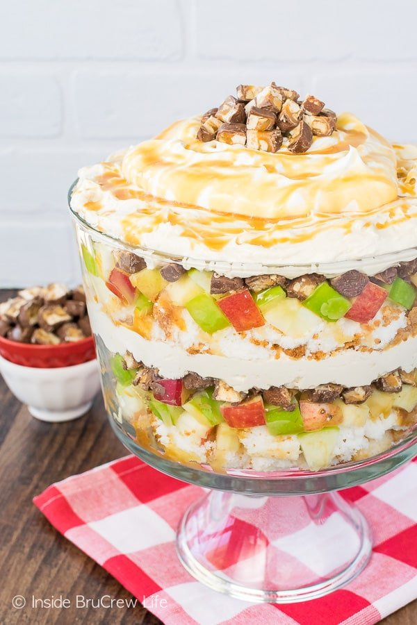 Apple Snickers Cheesecake Trifle - candy bars, apples, cake, and cheesecake make this no bake dessert recipe perfect for summer picnics or dinners!